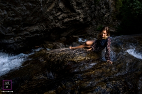 Idaho teen portrait of young woman sitting by a stream