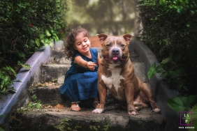Lifestyle Family Portraits in Lisbon Portugal - Photo contains: little girl, dog, outside, stairs, bushes