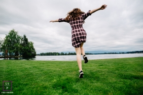 Seattle Washington Lifestyle Teen Portraits - Photo contains: girl, grass, lake, jumping, trees