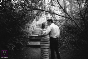 Lifestyle Maternity Portrait Photography in Seattle Washington | Image  contains: trees, outside, stairs, husband, wife, kissing, black, white
