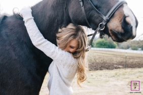 Lifestyle Teen Portrait Session in Seattle Washington | Photo contains: horse, senior, hugging, field, color, halter, hair