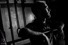 Lifestyle Portrait Photography in Arizona United States | Image contains: man, black, white, bar, indoors, sunlight