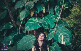 Lifestyle Portrait Photography in Minas Gerais Brazil | Image contains: woman, leaves, outside, posing, tree trunks, vines