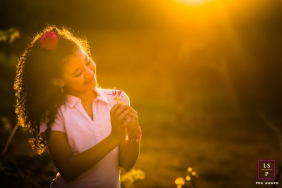 Lifestyle Portraits Session in Minas Gerais Brazil | Photo contains: sunlight, flowers, girl, smile, color, gold, pink