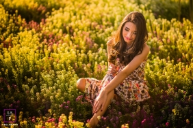 Minas Gerais Brazil Teen Photographer | Lifestyle Image contains: portrait, photoshoot, outdoor, session, plants, sunlight, sitting down, field, color, pink, green