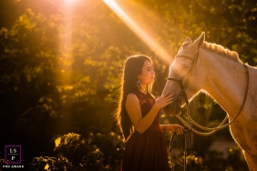 Minas Gerais Brazil  Teen Portraits | Lifestyle Photography - Image contains: outdoor session, horse, sunlight, bushes, girl, halter, earrings, golden