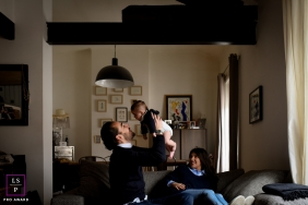 Lyon Auvergne-Rhone-Alpes Family Portraits | Lifestyle Photography - Image contains: indoor, group, family, baby, father, mother, couch, color, smiling