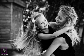 Marseille Bouches-du-Rhone Family Portraits | Lifestyle Photography - Image contains: outdoor, session, hair, swinging, hugging, smiling, flower, black, white