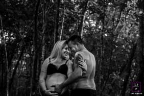 Lifestyle Maternity Couple Portrait Session in Santa Catarina Brazil | Photo contains: black, white, mother to be, father to be, trees, outdoors, smiling, bump