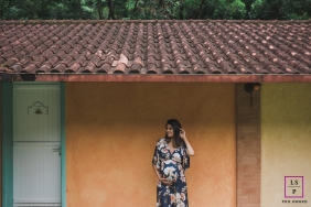 Lifestyle Maternity Portraits in Macae Rio de Janeiro - Photo contains: mother to be, bump, shack, door, roof, color, trees, outside