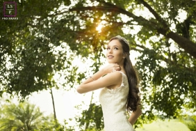 Teen Photography for Minas Gerais Brazil - Lifestyle Portrait contains: senior, girl, trees, sunlight, sky, outdoors