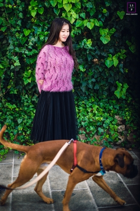 Teen Photographer in Beijing China | Lifestyle Image contains: dog, girl, senior, vines, sidewalk, leash, color, outside