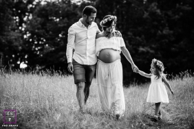 Family Portraits in Bourgogne-Franche-Comte France | Lifestyle Photography Session contains: mother, pregnancy, father, daughter, walk, field, black and white