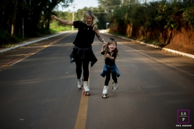 Family Photographer in London England | Lifestyle Image contains: mother, daughter, skating, road