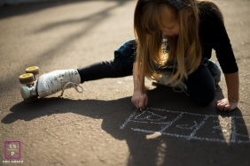 Girl Portraits in London England | Lifestyle Photography Session contains: female, play, sidewalk chalk, quad skates