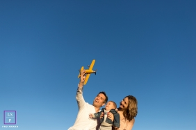 Family Portraits in London England | Lifestyle Photography Session contains: mother, father, son, sky, toy plane