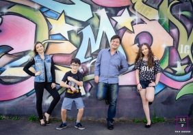 Family Photographer in Curitiba Parana | Lifestyle Image contains: father, mother, daughter, son, mural, wall, colorful
