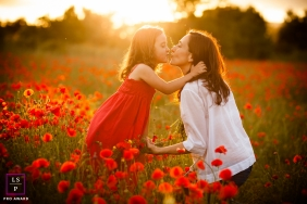 Family Portraits in Barcelona Spain | Lifestyle Photography Session contains: mother, daughter, kiss, field, flowers, afternoon