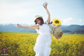 Family Photography for Barcelona Spain - Lifestyle Portrait contains: girl, basket, sunflower, field, flowers, hills, outdoors