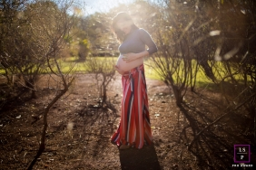 Maternity Photography for Sao Paulo Brazil - Lifestyle Portrait contains: woman, pregnant, belly, sunlight, trees