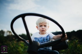 Family Portraits in Warsaw Mazowieckie | Lifestyle Photography Session contains: boy, tractor, wheel