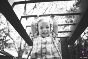 Family Portraits in Sao Paulo Brazil | Lifestyle Photography Session contains: boy, playground, monkey bars, smile, black and white