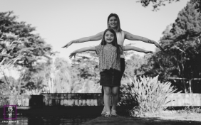 Family Photographer in Sao Paulo Brazil | Lifestyle Image contains:  mother, daughter, playful, black and white, water, balancing