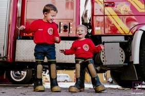 Family Portraits in Florianopolis Santa Catarina | Lifestyle Photography Session contains: boys, fire engine, truck, boots, fun, happy