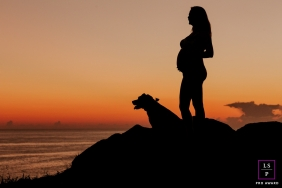 Maternity Portraits in Florianopolis Santa Catarina | Lifestyle Photography Session contains: woman, sunset, pregnant, dog, silhouette, water, beach