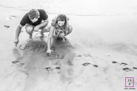 Couple Photographer in Rio de Janeiro Brazil | Lifestyle Image contains: black and white, wet sand, beach, footprints, writing, shoreline