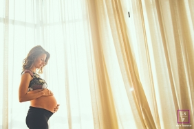 Maternity Photographer in Campinas Sao Paulo | Lifestyle Image contains:  pregnancy, woman, home, window, sheer, curtain, belly
