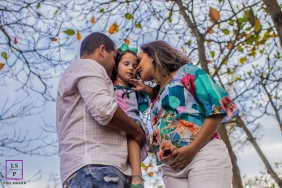 Family Maternity Photographer in  Macae Rio de Janeiro | Lifestyle Image contains: mother, father, daughter, trees, fall, low angle