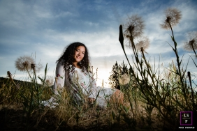 Teen Photographer in Coeur d'Alene Idaho | Lifestyle Image contains: dandelions, sunset, senior, girl, color, grass, sitting down