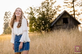 Teen Portraits in Coeur d'Alene Idaho | Lifestyle Photography Session contains: field, color, barn, female, smile, trees, outdoors