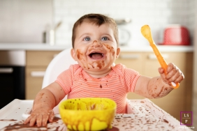 Marseille Baby Lifestyle Portrait Photography Bouches-du-Rhone | Image contains: toddler, kitchen, food, mess, closeup, highchair, spoon, bowl