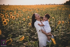Pistoia Mother and Son Lifestyle Photography Tuscany | Image contains: woman, boy, field, sunflowers