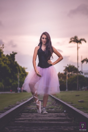 Minas Gerais Lifestyle Teen Portrait Session Brazil | Photo contains: girl, pose, ballet, shoe, grass, train, railway, tracks, palms, trees