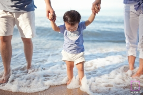Malacca Lifestyle Family Portrait Session Malaysia | Photo contains: mom, dad, son, ocean, waves, sand, shoreline