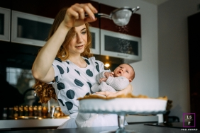 Brabant Wallon Family Lifestyle Photography Wallonie | Image contains: mother, infant, kitchen, tart, pie, sprinkle sugar, home