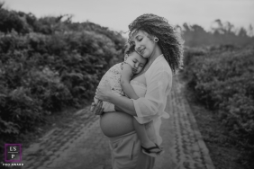 Rio de Janeiro Maternity Lifestyle Photography Brazil | Image contains: mother, daughter, hug, black and white, road, trail, nature, tire tracks