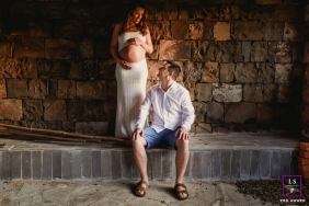 Rio Grande do Sul Maternity Lifestyle Portrait Session Brazil | Photo contains: couple, pregnancy, stone, block, tile, indoors