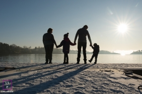 Akershus Lifestyle Family Portrait Photography Norway | Image contains: shore, snow, winter, water, lake, sunburst