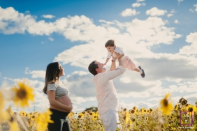 Federal District Family Lifestyle Portrait with Dad, Boy and Pregnant Mom - Photo contains: sunflowers, blue sky, clouds, field, maternity, portraiture, fun