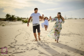 Ceara Family Lifestyle Portrait Session at the Beach in Brazil | Photo contains: father, mother, child, swinging, sand, footprints