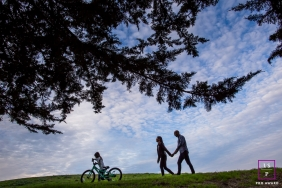 San Francisco California Family Day at the Park Lifestyle Portrait - Photo contains: tree, sky, grass, bike, bicycle, kid, couple