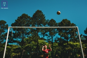 Rio Grande do Sul Soccer Boy Lifestyle Portrait in Brazil | Photo contains: blue, sky, ball, trees, park
