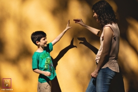 Rio Grande do Sul Brazil Mom and Son Lifestyle Portraits - Photo contains: family, female, boy, shadow puppets, play