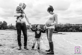 Maternity Lifestyle Portraits in France with the Family - Photo contains: mom, dad, children, pregnancy, water, sand, beach, black and white