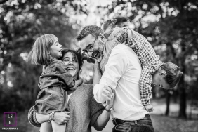 France Playful Family Lifestyle Portraits in Black and White - Photo contains: daughter, son, mother, father, smiling, outdoors, trees, upside down, picture, fine art