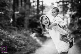 Bourgogne-Franche-Comte Family Lifestyle Photography with Mom and Son | Image contains: boy, mother, black, white, outdoors, piggyback ride, smiling, tips